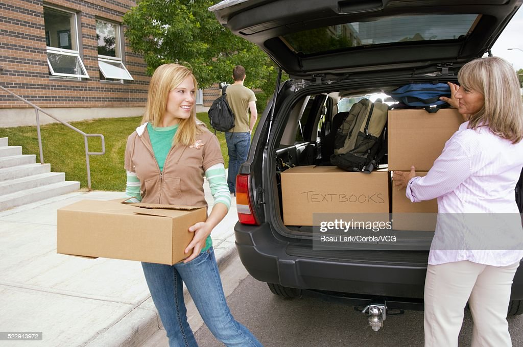 Mother dropping off daughter at school : Stock Photo