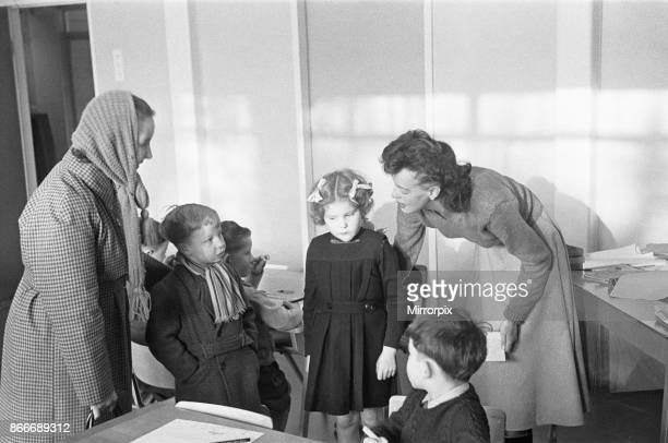 A mother drops off her son at his new school South Mead School Southfield Wimbledon as the Teacher finds him a classroom mentor 14th January 1954