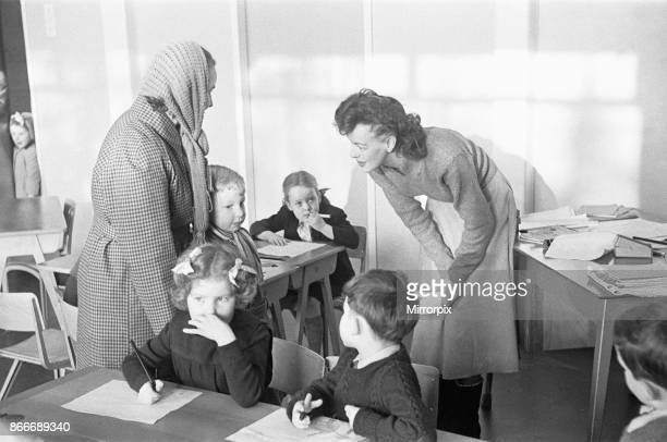 A mother drops off her son at his new school South Mead School Southfield Wimbledon Seen here meeting his new teacher for the first time 14th January...