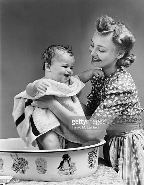 Mother Drying Baby Boy With Towel