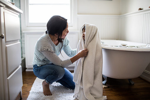 Mother drying daughter off (2yrs) after bath - gettyimageskorea