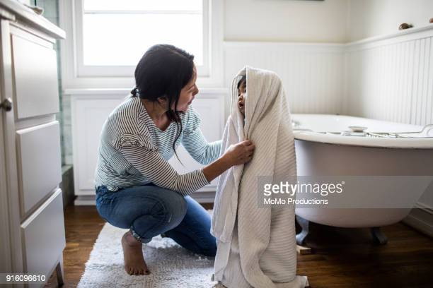mother drying daughter off (2yrs) after bath - bathroom stock photos and pictures
