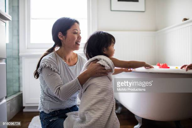 mother drying daughter off (2yrs) after bath - mother daughter towel stock photos and pictures