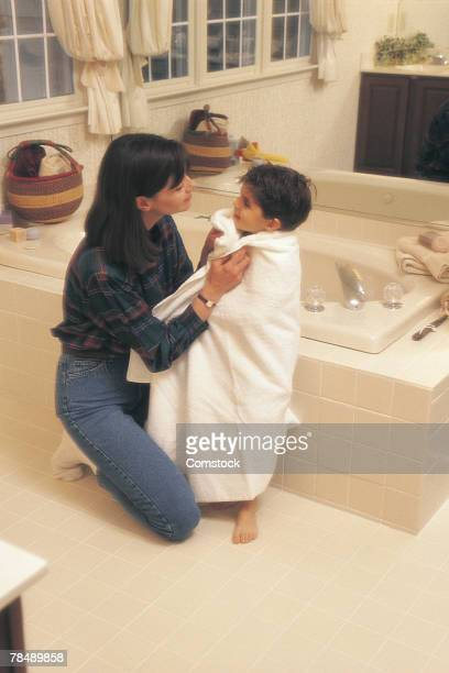Mother drying off child after bath