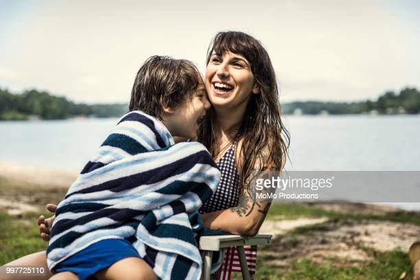 mother drying her son with towel