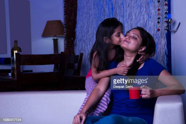 mother duaghter love - stock images - indian girl kissing stock photos and pictures