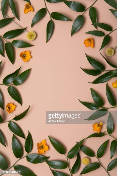 mother earth day on beige background with green leaves. flat lay. concept green world earth day. - giornata mondiale della terra foto e immagini stock