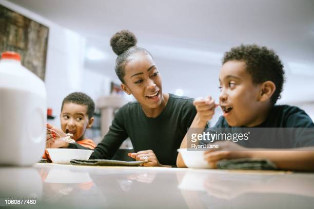 Mother Eating Breakfast With Her Two Boys