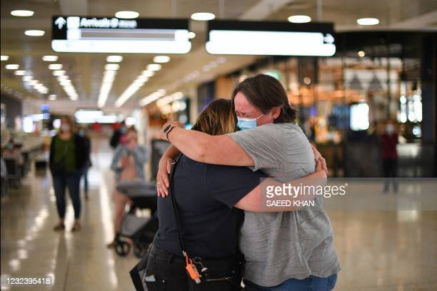 Mother embraces her daughter upon her arrival from New Zealand at Sydney International Airport on April 19 as Australia and New Zealand opened a...