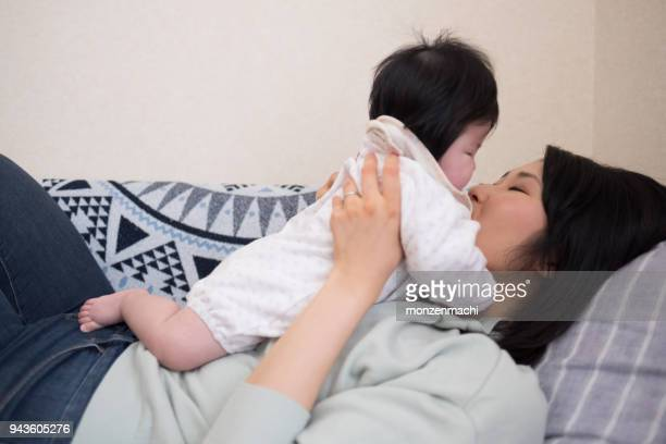 Mother embracing baby