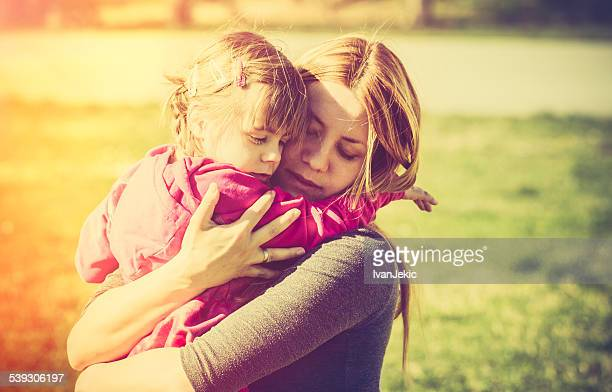 Mother embracing child in nature