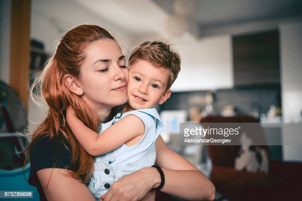 mother embracing her cute smiling baby son - single mother stock photos and pictures