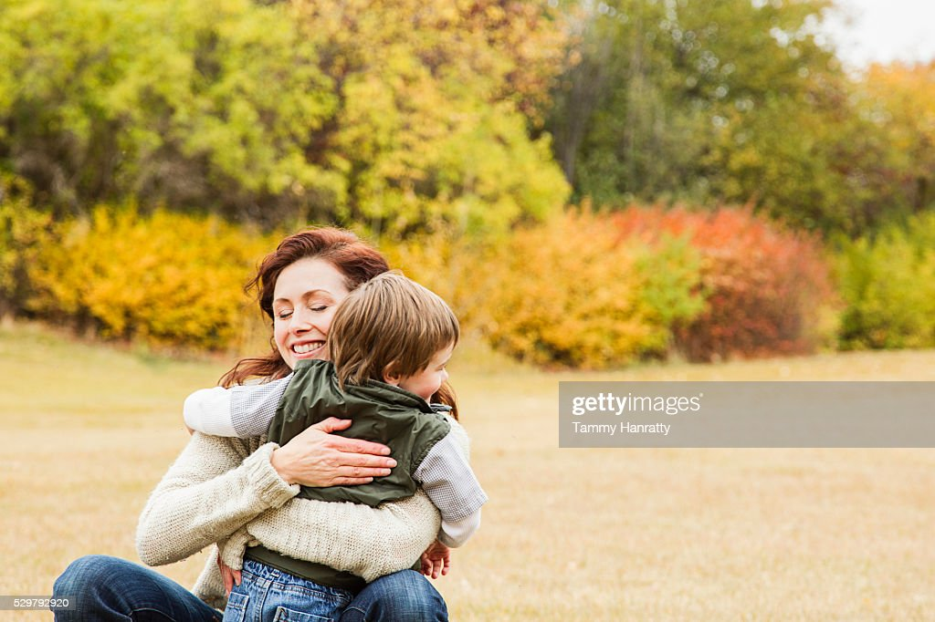 Mother embracing her son (4-5) : Stock Photo