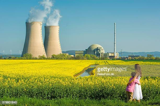 Mother embracing Son in Front of Nuclear power station