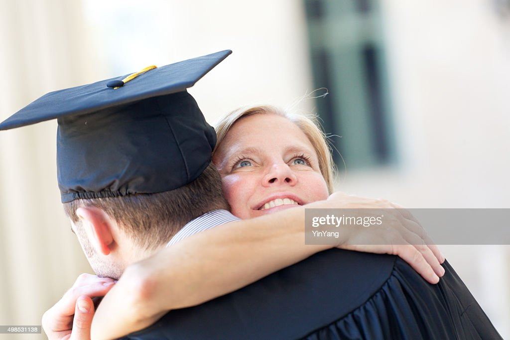 c46d927eb43 Mother Embrassing Graduating Son in Graduation Ceremony Horizontal   Stock  Photo