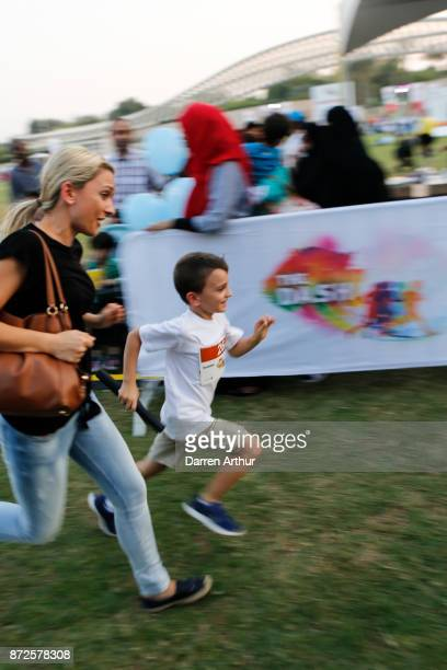 Mother encourages her son as he competes during the Abu Dhabi Mini Dash 2017 at Umm Al Emarat Park on November 10 2017 in Abu Dhabi United Arab...