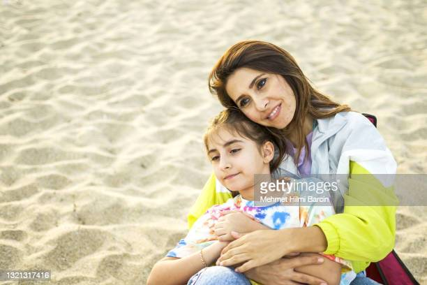 mother enjoyment her daughter at beach - turkey middle east stock pictures, royalty-free photos & images
