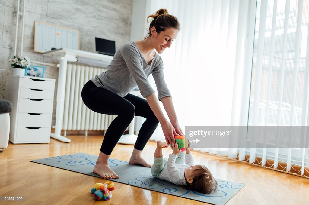 Mother Exercise With Her Baby At Home : Stock Photo