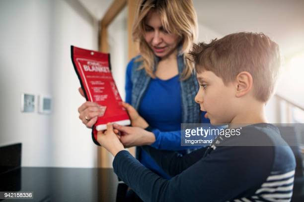 mother explaining fire to her son - safety stock pictures, royalty-free photos & images