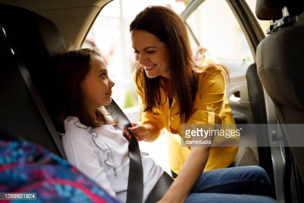 mother fastening child safety seat belt in car - buckle stock pictures, royalty-free photos & images