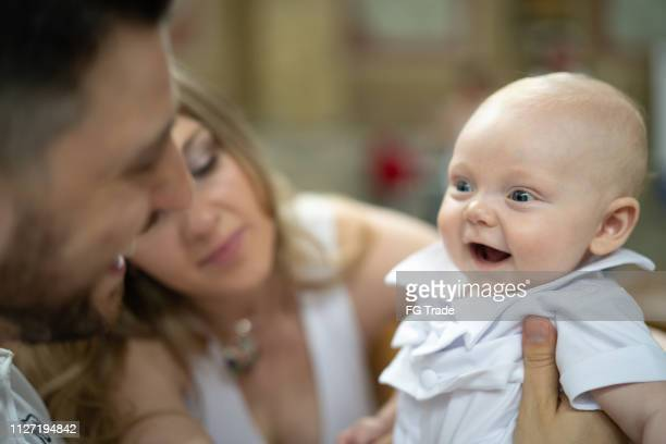mother father and baby child having fun - baptism stock pictures, royalty-free photos & images
