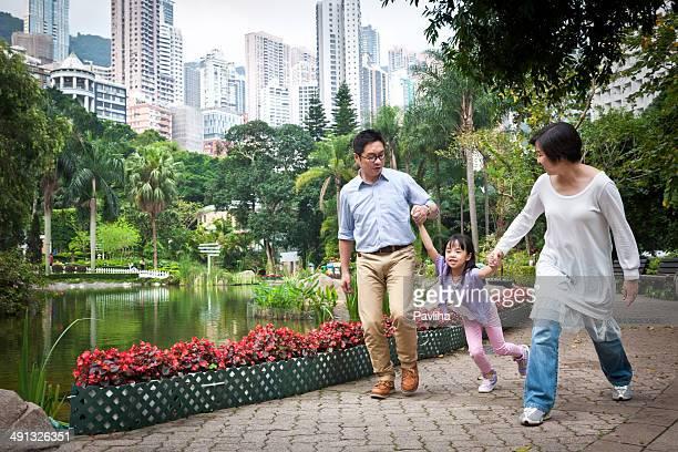 Mother, Father and Daughter Playing, Hong Kong, China