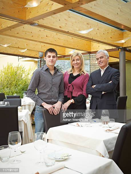 Mother Father and Son in a Restaurant. Handing down the business