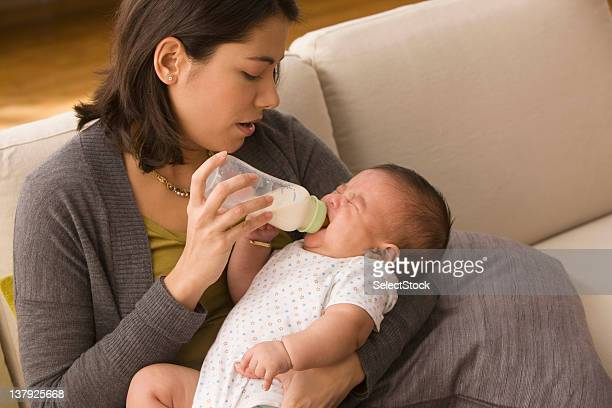 Mother feeding baby bottle