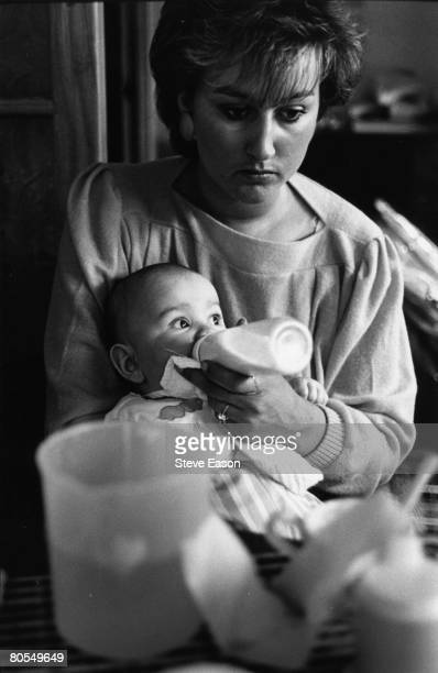 A mother feeding her baby from a bottle in Teeside March 1986