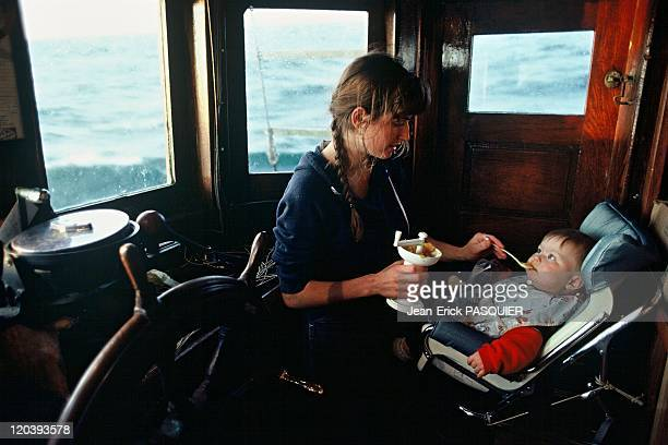Mother feeding her child in Alaska United States on a fishing boat