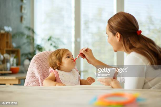 Mother feeding the baby