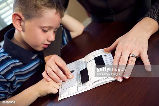 Mother fingerprinting son