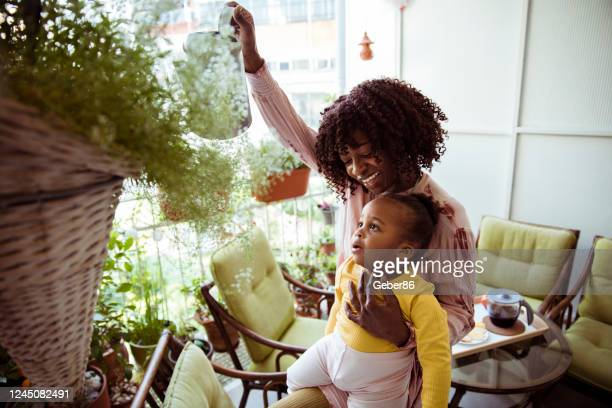 mother flowering plants with her daughter - gardening stock pictures, royalty-free photos & images