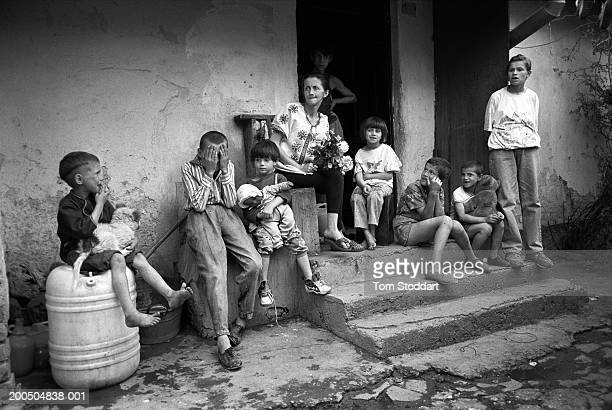 Bosnia Sarajevo May 1994 A mother from a poor family sits outside her home with eight of her ten children During the 47 months between the spring of...