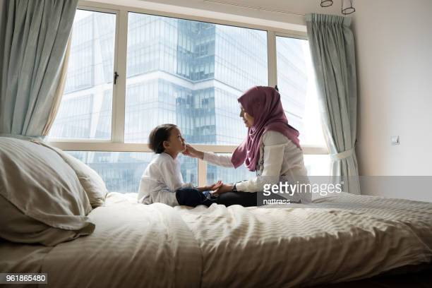 mother gets her daughter ready for school - malaysian culture stock pictures, royalty-free photos & images