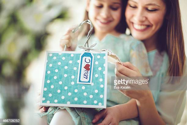 Mother getting a mother's day present from her daughter