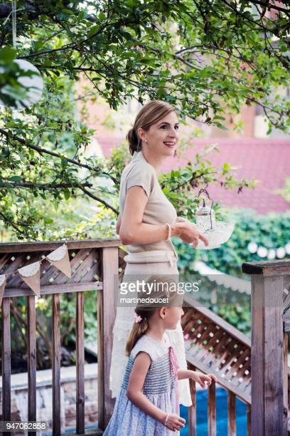 mother getting backyard ready for outdoors baptism. - catholic baptism stock pictures, royalty-free photos & images