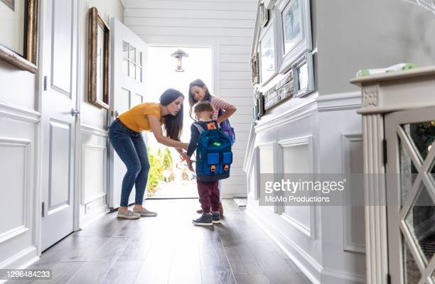 mother getting children ready for school - education stock pictures, royalty-free photos & images