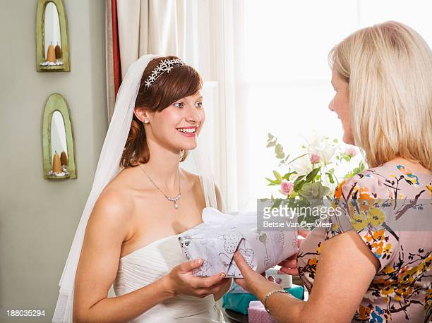 Mother gives present to bride.