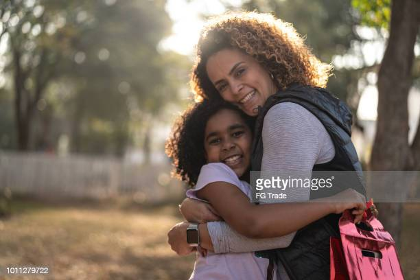 mother giving a gift for your her daughter - black mothers day stock pictures, royalty-free photos & images