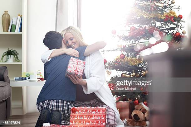 Mother giving christmas wishes to her son