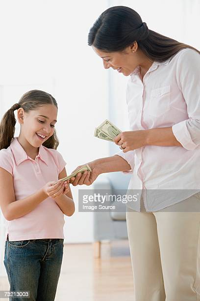 Mother giving daughter pocket money