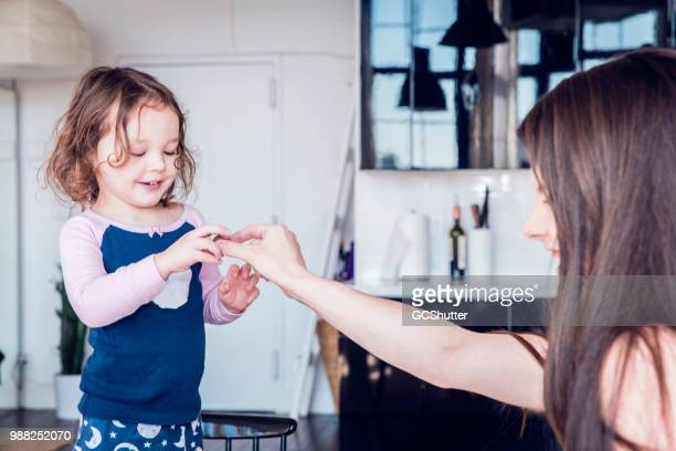 Mother giving her daughter a piece of chocolate