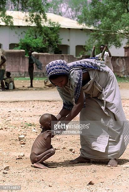 A mother grabs her starvationsuffering baby 19 October 1992 in Bur Acaba southeast of Somalia International effort to save Somalia's starving...