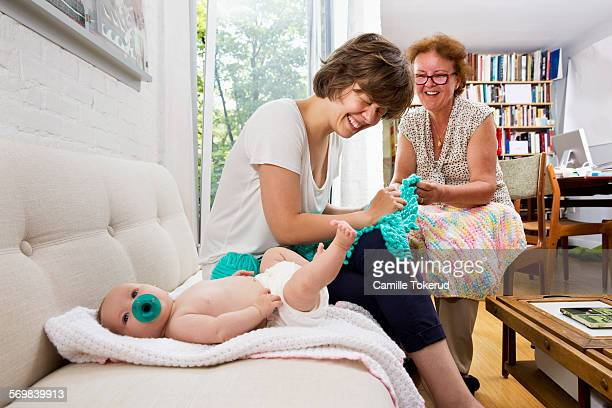 Mother, grandmother and baby in livingroom