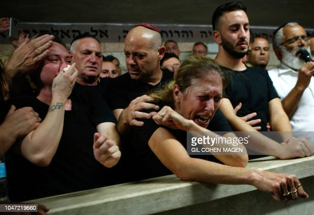 Mother Hava and relatives and friends mourn during the funeral of Kim Levengrond Yehezkel aged 28 one of the two Israeli nationals killed earlier in...