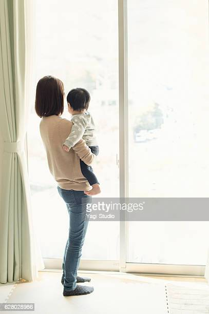 Mother having a good time with baby girl at home