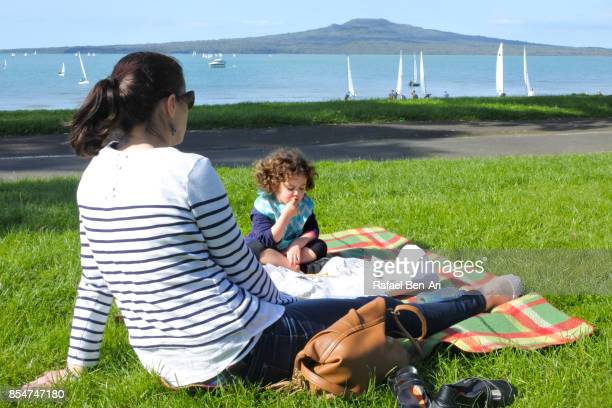 Mother having a picnic with her daughter on the beach