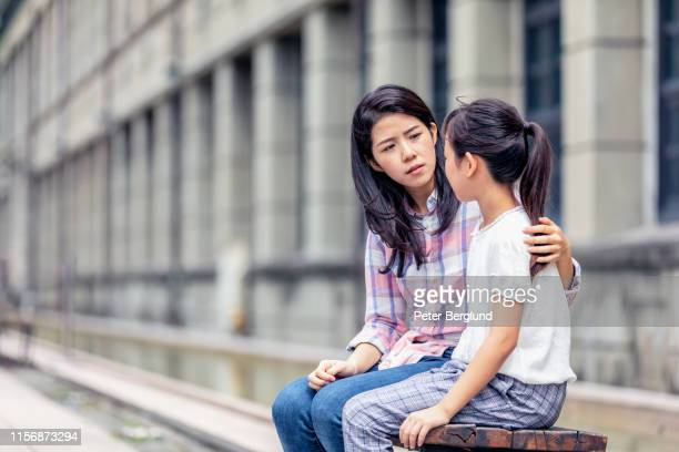 a mother having a serious talk with her daughter - parent stock pictures, royalty-free photos & images