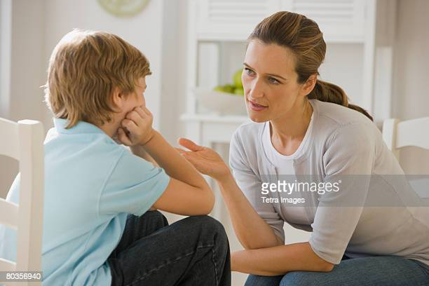 mother having discussion with son - penalty stock pictures, royalty-free photos & images